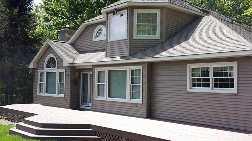 Vinyl and wood siding installation
